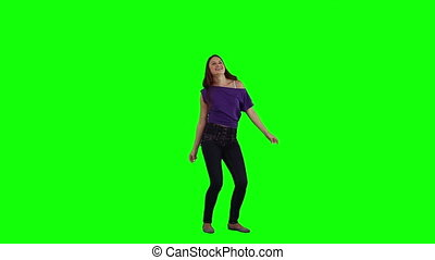 A brunette woman is dancing