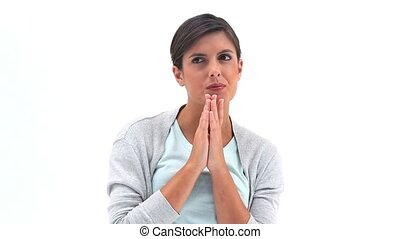 A brunette woman is praying
