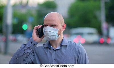 brutal masked man dials a phone number and calls