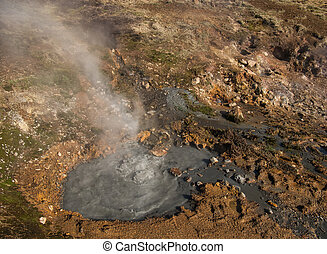 A bubbling geothermal spring near Reykjadalur