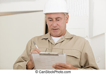 a builder in with clipboard