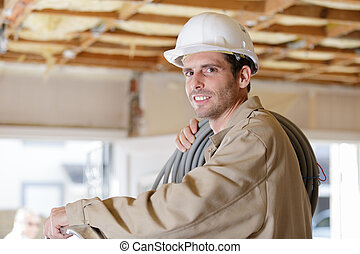 a builder looking at camera
