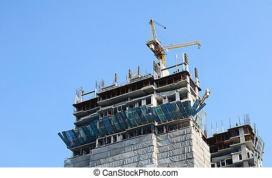 A building under construction with blue sky.