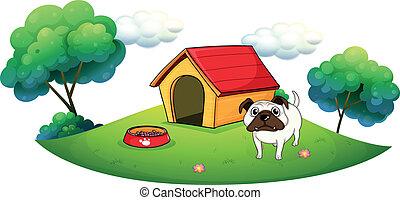 A bulldog outside its dog house