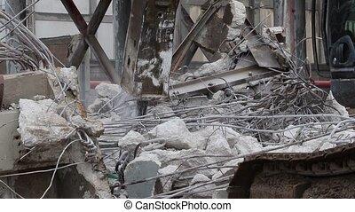 A bulldozer demolishes building on construction site