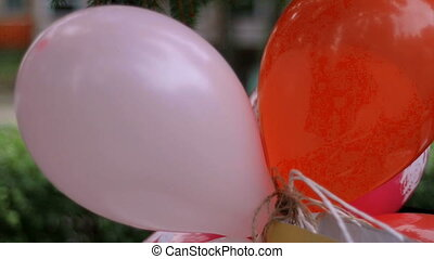 a bunch of big beautiful colored balloons close-up