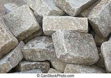a bunch of cobblestones at a building site