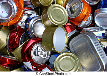 A bunch of crushed alumnium cans all together for recycling to help be green for the Earth and to be enviromentaly friendly