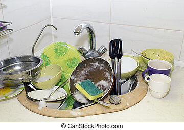 A bunch of dirty dishes in the kitchen.
