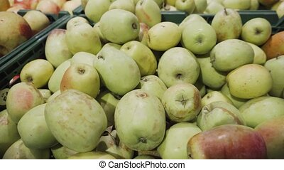 A bunch of green apples piled up at the supermarket. - A...