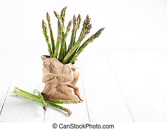 A bunch of green asparagus in paper bag