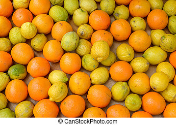 lemons and oranges in a wooden box