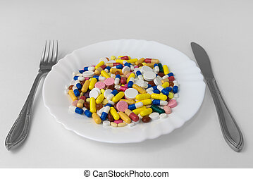 A bunch of pills on a plate
