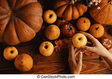 A bunch of pumpkins and apples.