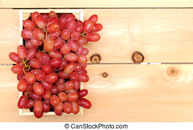 a bunch of red grape in case