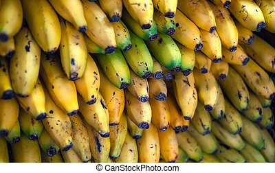 a bunch of ripe bananas at the market stall