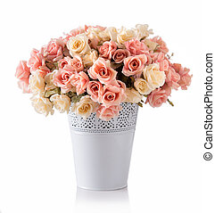 A bunch of roses in white ceramic vase, isolated