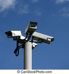 A Bunch of Security Cameras with Blue Sky