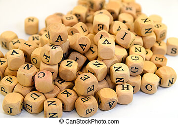 letters - a bunch of small wooden cubes with letters