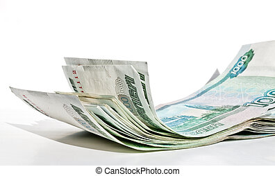 A bundle of 1000-ruble bills lying carelessly on the surface