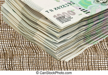A bundle of money on the background of burlap