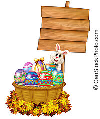 A bunny and a basket with eggs near a signage