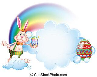 A bunny holding an egg near the rainbow - Illustration of a...