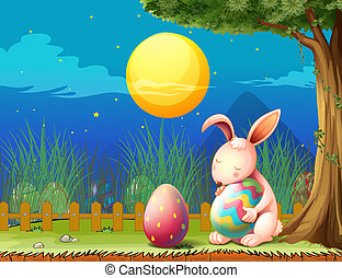 A bunny in the fence with two easter eggs