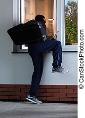 A burglar enters someone's apartment