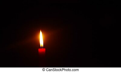 burning candle - a burning candle in darkness, time lapse...