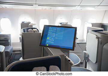 A business class clean cabin of the airplane - monitors...