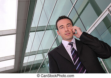 a business man at phone