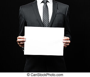business man holding a paper