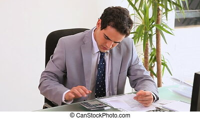 A business man looks stressed