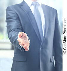 A business man with an open hand ready to seal a deal