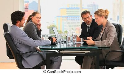 A business meeting with four business people