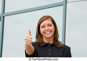 Business Woman Giving a Thumbs Up