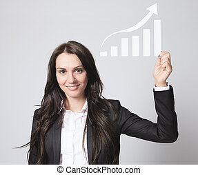 A Business woman holding aDiagram in front of a gray background.