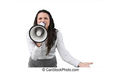 A business woman shouts into a megaphone