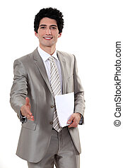 A businessman about to shake hands.
