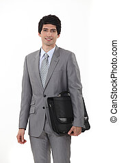 A businessman carrying his briefcase.
