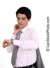 A businessman checking his watch.