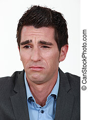 A businessman frowning.