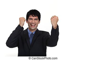A businessman gesturing victory.
