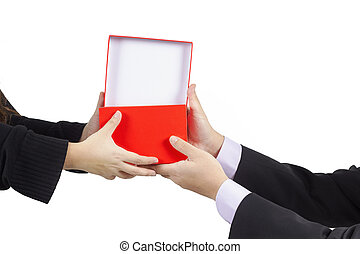 A businessman giveing a gift box to his woman isolated on white background and work path