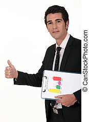A businessman giving the thumb up.