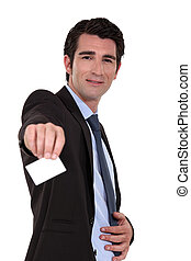 A businessman handing his business card.