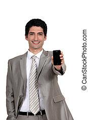 A businessman handing his phone.