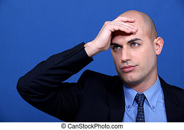 A businessman having a headache.