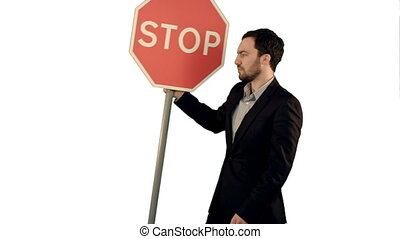 A businessman holding a stop sign on laptop on white background isolated.